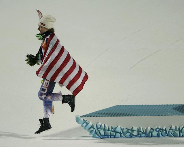 Women's gold medalist, United States' Mikaela Shiffrin, leaves the podium after the flower ceremony for the women's slalom at the Sochi 2014 Winter Olympics, Friday, Feb. 21, 2014, in Krasnaya Polyana, Russia. (AP Photo/Charlie Riedel)