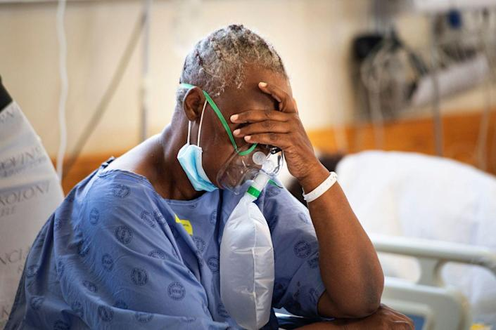 A patient breathes in oxygen in the COVID-19 ward