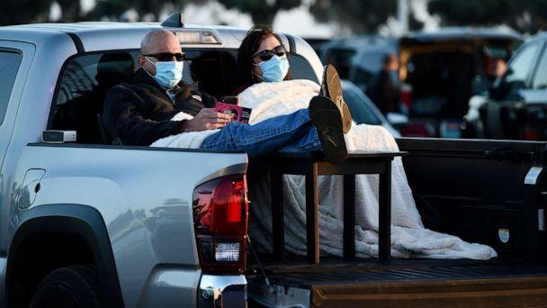 PHOTO: Chris Cdebaca of Oxnard, Calif. and his wife Avonna Ramsey await the start of Third Eye Blind's performance at Concerts in your Car at the Ventura County Fairgrounds on Saturday, July 25, 2020, in Ventura, Calif. (Chris Pizzello/Invision/AP)