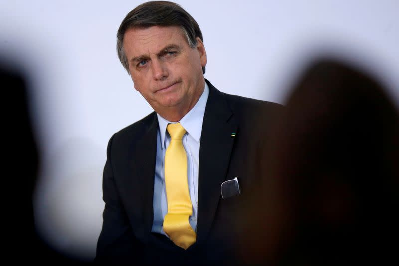 FILE PHOTO: Brazil's President Jair Bolsonaro looks on during the COVID-19 Clinical Study Result Announcement Ceremony in Brasilia