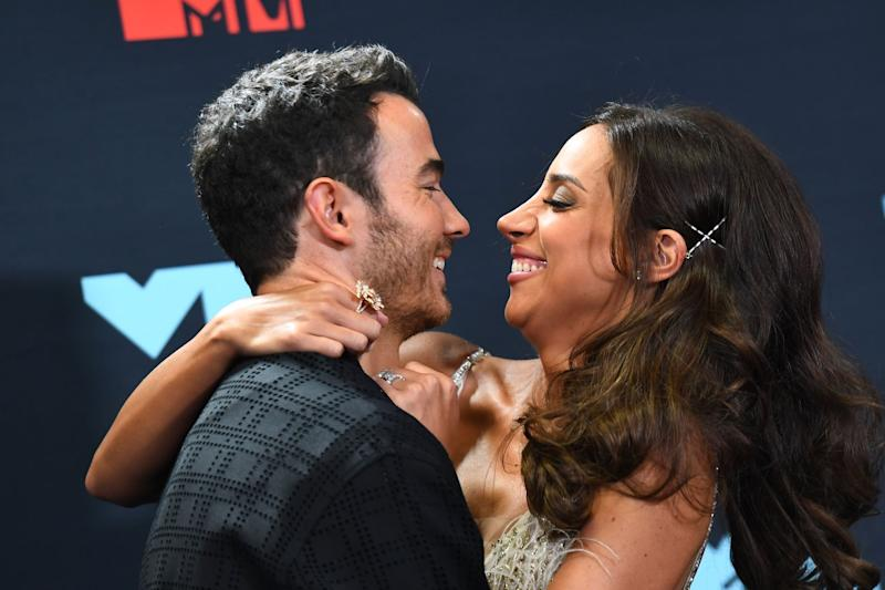 US musician Kevin Jonas (L) and wife Danielle Jonas pose in the press room during the 2019 MTV Video Music Awards at the Prudential Center in Newark, New Jersey on August 26, 2019. (Photo by Johannes EISELE / AFP) (Photo credit should read JOHANNES EISELE/AFP via Getty Images)