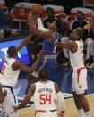 New York Knicks shooting guard RJ Barrett (9) drives to the basket against LA Clippers center Serge Ibaka (9) and small forward Kawhi Leonard (2) during the first half of an NBA basketball game Sunday, Jan. 31, 2021, in New York. (Brad Penner/Pool Photo via AP)