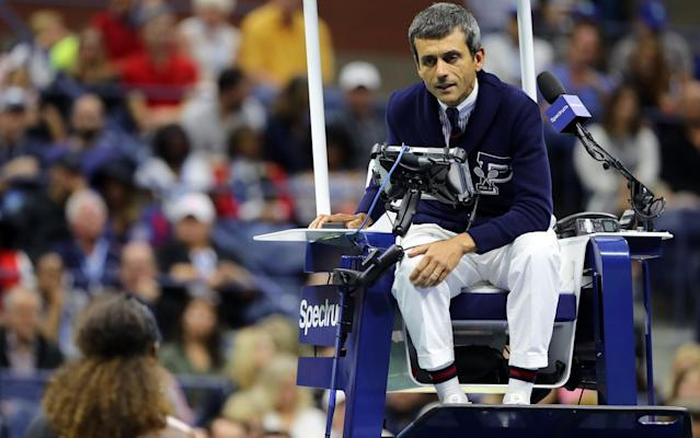 Umpire Carlos Ramos talks to Serena Williams during Saturday's US Open final - Getty Images North America