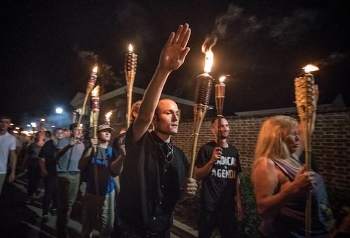 """Chanting, """"White lives matter! You will not replace us!"""" and """"Jews will not replace us!"""" white nationalists and white supremacists march through the University of Virginia campus on Aug. 11, 2017. (Photo: Evelyn Hockstein for the Washington Post via Getty Images)"""