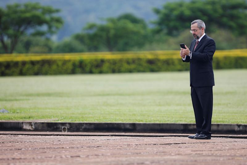 Brazil's Education Minister Abraham Weintraub uses a phone after a ceremony of the hoisting the national flag in front the Alvorada Palace in Brasilia, Brazil January 21, 2020. REUTERS/Adriano Machado