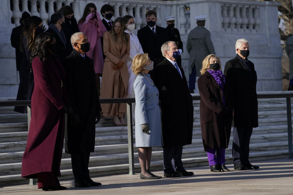 FILE - In this Jan. 20, 2021, file photo former President Barack Obama and his wife Michelle, former President George W. Bush and his wife Laura and former President Bill Clinton and his wife former Secretary of State Hillary Clinton stand at the Tomb of the Unknown Soldier at Arlington National Cemetery during Inauguration Day ceremonies in Arlington, Va. (AP Photo/Evan Vucci, File)