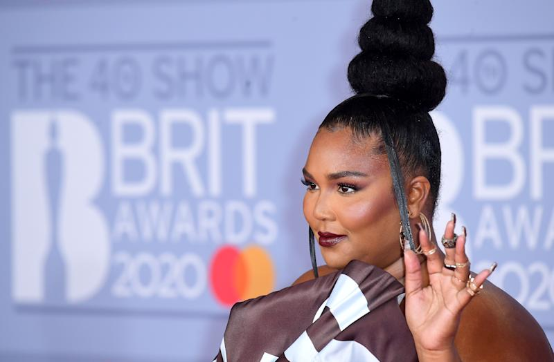 Lizzo arrived in custom Moschino. (Getty Images)