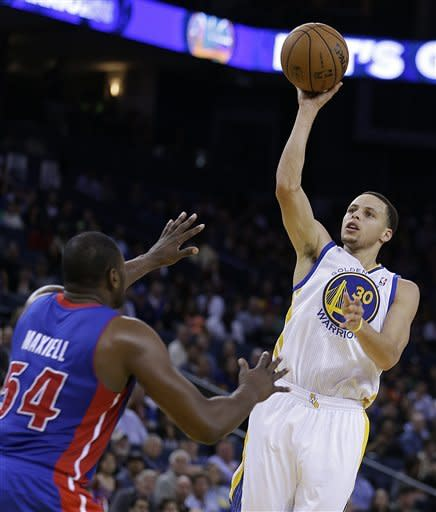 Golden State Warriors' Stephen Curry, right, shoots over Detroit Pistons' Jason Maxiell during the second half of an NBA basketball game Wednesday, March 13, 2013, in Oakland, Calif. (AP Photo/Ben Margot)