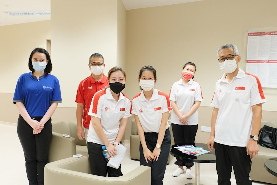 Minister for Culture, Community and Youth Edwin Tong (second from left) with national shooters (from third from left) Adele Tan, Tessa Neo and Ho Shu Yi, as well as national Song Haiping (right), taking their first dose of COVID-19 vaccination. (PHOTO: Edwin Tong/Facebook)