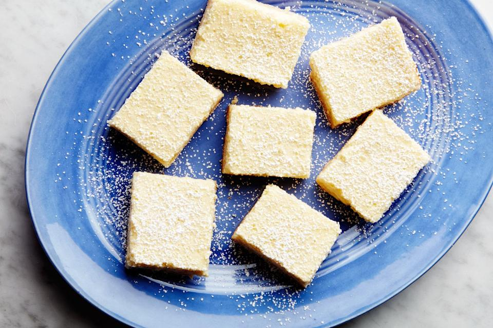 """These bars, from a classic back-of-the-box recipe, are as refreshing as an icy glass of lemonade. <a href=""""https://www.epicurious.com/recipes/food/views/carnation-lemon-bars?mbid=synd_yahoo_rss"""" rel=""""nofollow noopener"""" target=""""_blank"""" data-ylk=""""slk:See recipe."""" class=""""link rapid-noclick-resp"""">See recipe.</a>"""