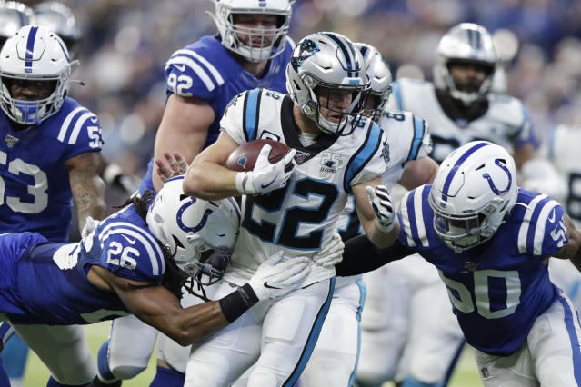 Carolina Panthers' Christian McCaffrey (22) is tackled by Indianapolis Colts' Clayton Geathers (26) and Anthony Walker (50) during the first half of an NFL football game, Sunday, Dec. 22, 2019, in Indianapolis. (AP Photo/Michael Conroy)