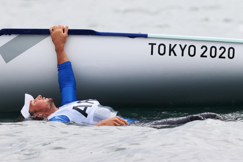 <p>Facundo Mario Olezza Bazan of Team Argentina cools off in the water as he competes in the Men's Finn class on day four of the Tokyo 2020 Olympic Games at Enoshima Yacht Harbour on July 27, 2021 in Fujisawa, Kanagawa, Japan. (Photo by Phil Walter/Getty Images)</p>