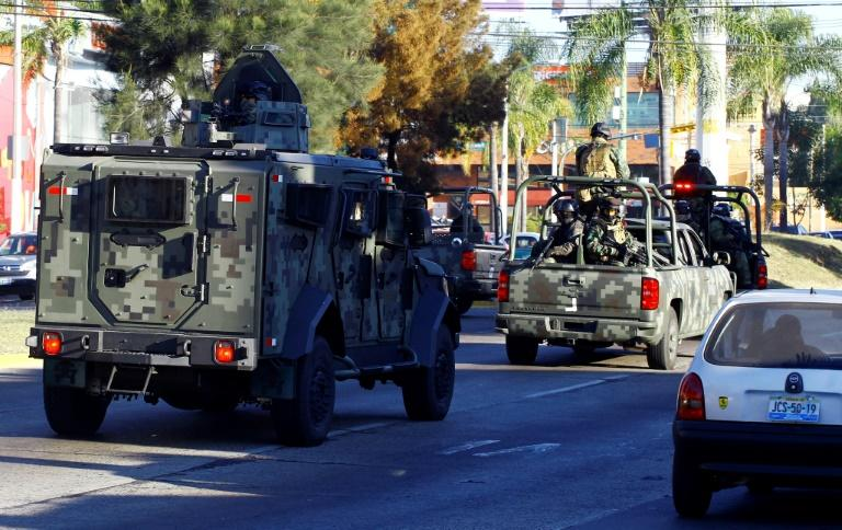 Mexican soldiers with an armoured car patrol the streets during a 2014 operation against the Jalisco Next Generation narcotics cartel