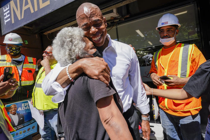 Democratic mayoral candidate Eric Adams hugs a supporter after a campaign event, Thursday, June 17, 2021, in the Harlem neighborhood of New York. (Mary Altaffer/AP)