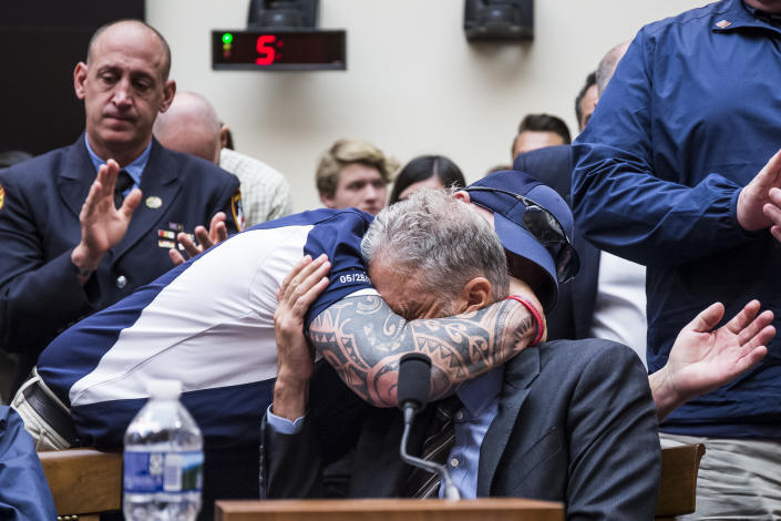 FealGood Foundation co-founder John Feal hugs Jon Stewart during a House Judiciary Committee hearing on 9/11 first responders. (Photo: Zach Gibson/Getty Images)