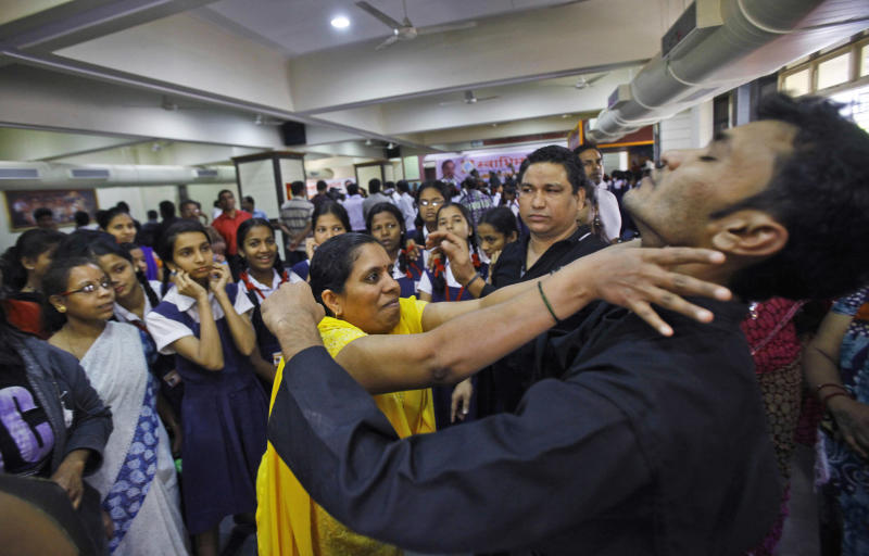 School children and staff watch a self defense training program at a school in Mumbai, India, Friday, Jan. 4, 2013. An attack on a 23-year-old woman, who died of severe internal injuries over the weekend, has provoked a fierce debate across India about the routine mistreatment of women and triggered daily protests demanding action. Indian Home Minister Sushilkumar Shinde announced a special recruitment drive for women police officers Thursday and ordered every police station in the capital to be staffed by at least nine female officers to make them more attentive to women's needs. (AP Photo/Rafiq Maqbool)