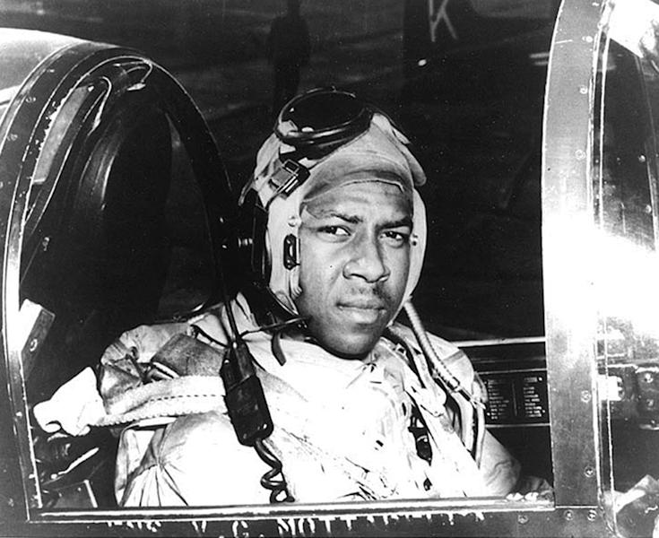 FILE - In this undated file photo from around 1950 provided by the U.S. Navy, Ensign Jesse Brown, who died in December 1950 after his plane crashed in North Korea, sits in a cockpit of his plane. Two years after he made history by becoming the Navy's first black pilot Brown lay trapped in his downed fighter plane in subfreezing North Korea, his leg broken and bleeding. His wingman crash-landed to try to save him, and even burned his hands trying to put out the flames. A chopper hovered nearby. Lt. j.g. Thomas Hudner could save himself, but not his friend. Hudner heads to Pyongyang on Saturday, July 20, 2013 with hopes of traveling in the coming week to the region known in North Korea as the Jangjin Reservoir, accompanied by soldiers from the Korean People's Army, to the spot where Brown died in December 1950. (AP Photo/U.S. Navy, File)