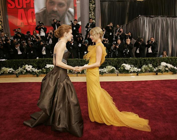 2006: Amy Adams, left, and Michelle Williams meet on the red carpet