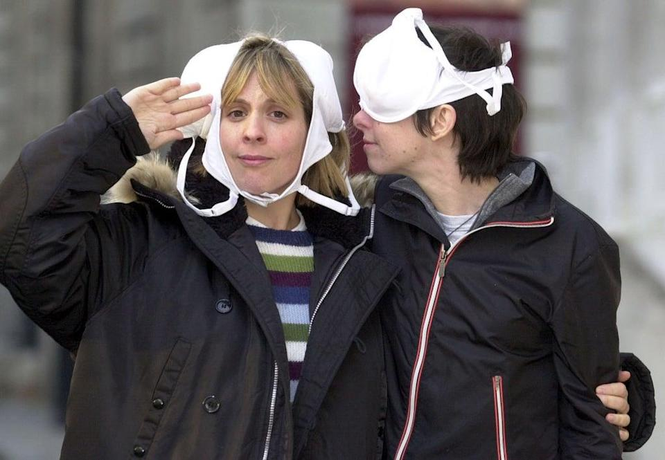 Mel Giedroyc and Sue Perkins clown around in central London. during the launch of Funny Women – an evening of stand-up comedy – which took place in 2002 in aid of breast cancer charities (PA)