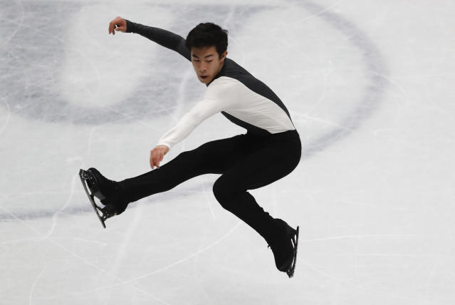 U.S. Nathan Chen performs during men's short program at the Figure Skating World Championships in Assago, near Milan, Thursday, March 22, 2018. (AP Photo/Antonio Calanni)