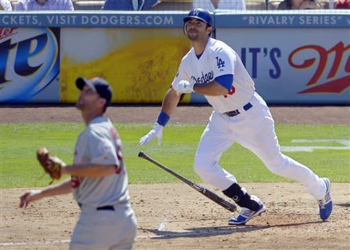 Los Angeles Dodgers' Andre Ethier, right, watches his ball go out for a two-run home run along with St. Louis Cardinals starting pitcher Adam Wainwright during the third inning of their baseball game, Sunday, Sept. 16, 2012, in Los Angeles. (AP Photo/Mark J. Terrill)