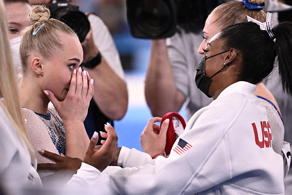 Russia's Angelina Melnikova (L) congratulates Simon Byles of the United States as Russia wins the final of the Art Gymnastics Women's Team at the Ariak Gymnastics Center in Tokyo on July 27 during the Tokyo 2020 Olympics.  2021. (Lionel Bonaventure / AFP Photo) (Lionel Bonaventure / AFP Photo via Getty Images)