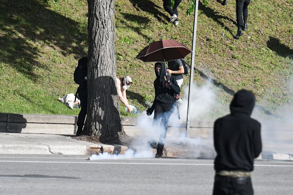 Montreal Police uses tear gas during a march against police brutality and racism in Montreal, Canada, on June 7, 2020. - On May 25, 2020, Floyd, a 46-year-old black man suspected of passing a counterfeit $20 bill, died in Minneapolis after Derek Chauvin, a white police officer, pressed his knee to Floyd's neck for almost nine minutes. (Photo by MARTIN OUELLET-DIOTTE / AFP) (Photo by MARTIN OUELLET-DIOTTE/AFP via Getty Images)