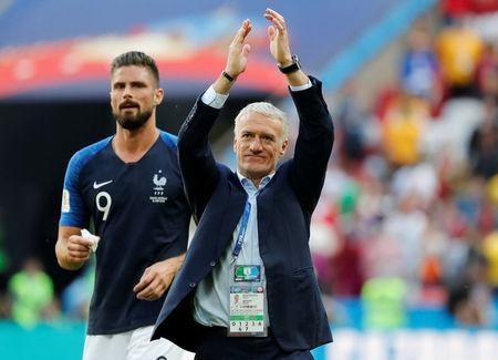 Soccer Football - World Cup - Group C - France vs Australia - Kazan Arena, Kazan, Russia - June 16, 2018 France coach Didier Deschamps and Olivier Giroud celebrate after the match REUTERS/Toru Hanai