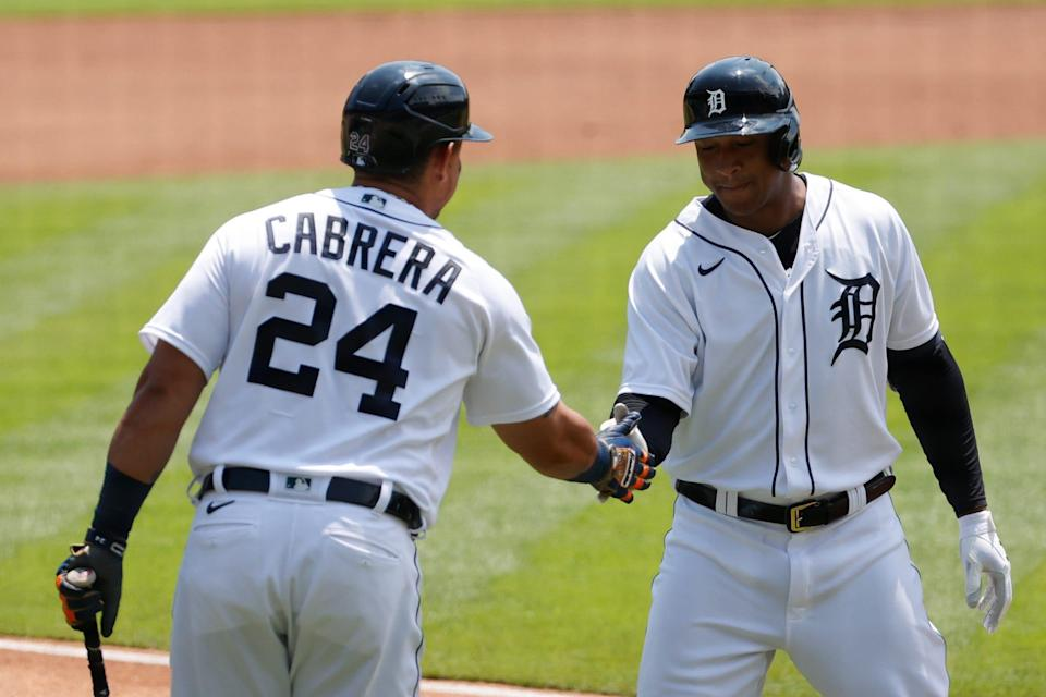 Detroit Tigers second baseman Jonathan Schoop (7) receives congratulations from designated hitter Miguel Cabrera (24) after he hits a home run in the first inning June 10, 2021 against the Seattle Mariners at Comerica Park.