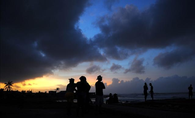 <p>Locals enjoy sunset after the passage of Hurricane Irma, in Cojimar neighborhood in Havana, on Sept. 10, 2017. (Photo: Yamil Lage/AFP/Getty Images) </p>