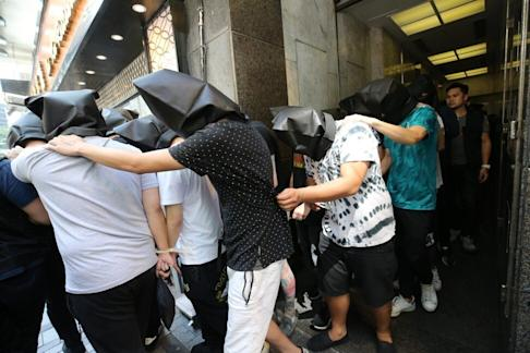Thirty-nine people, including some suspected triad members, are rounded up at a bar in Tsim Sha Tsui in 2018. Photo: Dickson Lee