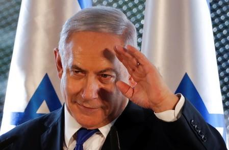 Israeli Prime Minister Benjamin Netanyahu gestures as he speaks during a state memorial ceremony at the Tomb of the Patriarchs, a shrine holy to Jews and Muslims, in Hebron