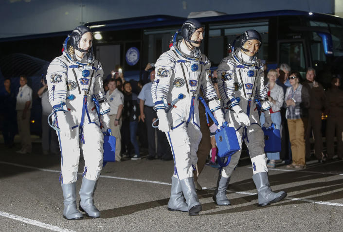 <p>U.S. astronaut Kate Rubins, left, Russian cosmonaut Anatoly Ivanishin, centre, and Japanese astronaut Takuya Onishi, members of the main crew of the expedition to the International Space Station (ISS), walk to report to members of the State Committee prior to the launch of Soyuz MS space ship at the Russian leased Baikonur cosmodrome, Kazakhstan, Thursday, July 7, 2016. (Shamil Zhumatov/Pool Photo via AP) </p>