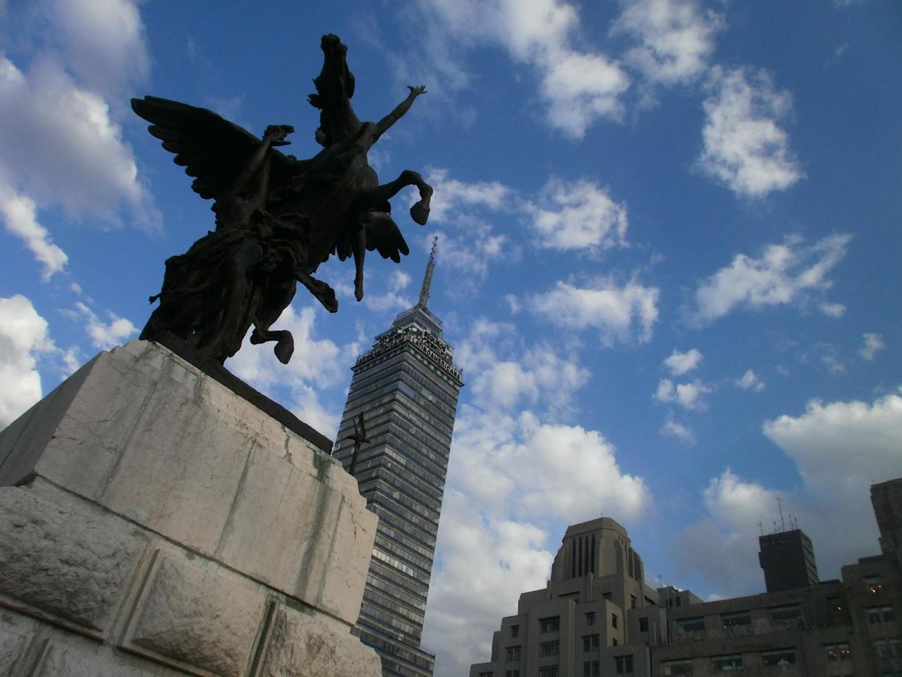 In this photo taken Aug. 19, 2011 and released by blind photographer Jose Sebastian, a sculpture next to Mexico City's Palace of Fine Arts and the Torre Latinoamericana building stand out against the skyline on Aug. 19, 2011. Sebastian is one of the 30 visually impaired or blind people learning photography with the help of the Mexico City foundation Ojos Que Sienten, or Eyes That Feel. (AP Photo/Jose Sebastian-Ojos que Sienten)