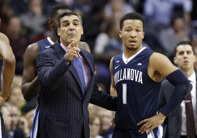 Villanova head coach Jay Wright points with Villanova guard Jalen Brunson (1) next to him during the first half of an NCAA college basketball game against Georgetown, Wednesday, Jan. 17, 2018, in Washington. (AP Photo/Alex Brandon)
