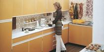 <p>We still can't figure out why someone thought burnt orange or pea green cabinetry was a good idea and we're happy to keep this trend in the past. </p>