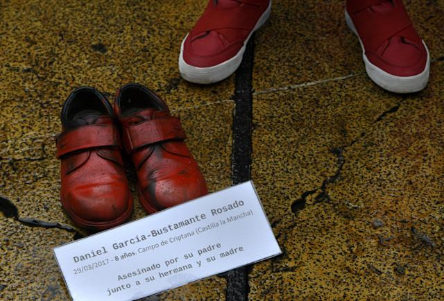 "<p>A boy looks at the shoes of another murdered child during performance organized by the NGO International Amnesty on the World Day for the Elimination of Violence against Women at the town hall square of Oviedo, northern Spain, Nov. 25, 2017. The banner reads: ""Daniel Garcia-Bustamante Rosado, 29/03/2017-8 years. Campo de Criptana (Castilla La Mancha) Killed by his father together with his sister and mother"". (Photo: Eloy Alonso/Reuters) </p>"