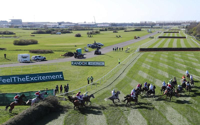 The field takes the Canal Turn in the Topham Chase on Ladies Day of the Randox Health Grand National Festival at Aintree Racecourse. PRESS ASSOCIATION Photo. Picture date: Friday April 7, 2017. See PA story RACING Aintree. Photo credit should read: David Davies/PA Wire - Credit: David Davies/PA