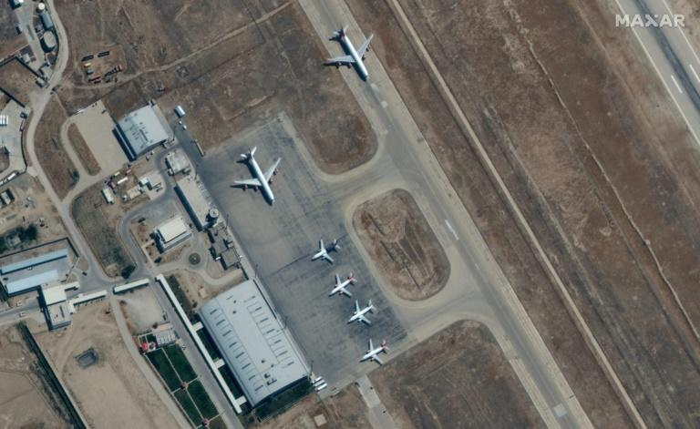 Satellite images from Maxar Technologies show six planes on September 3 at the Mazar-i-Sharif airport in northern Afghanistan, where there are reports several hundred people have been prevented from leaving the country (AFP/-)