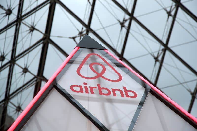 Airbnb logo is seen on a little mini pyramid under the glass Pyramid of the Louvre museum in Paris