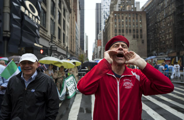 <p>Curtis Sliwa, right, founder of the Guardian Angels, yells toward New York Mayor Bill de Blasio during the annual Columbus Day Parade in New York, Monday, Oct. 9, 2017. (Photo: Craig Ruttle/AP) </p>