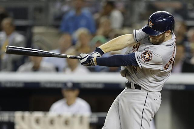Houston Astros' Robbie Grossman follows through on a two run single during the seventh inning of a baseball game against the New York Yankees Wednesday, Aug. 20, 2014, in New York. (AP Photo/Frank Franklin II)