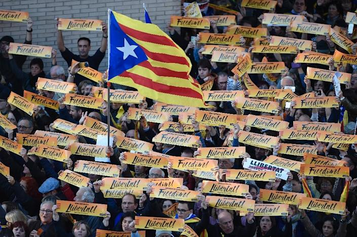 Independence supporters have held huge protests in Catalonia in recent weeks - but polls suggest they may not win an overall majority in the December 21 ballot (AFP Photo/Josep LAGO)
