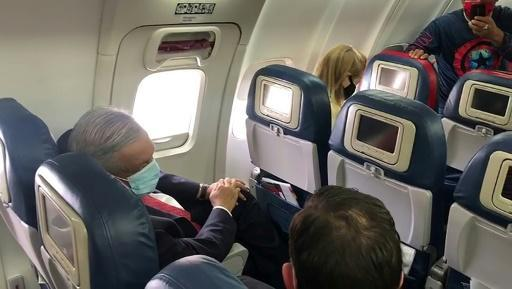 Mexican President Andres Manuel Lopez Obrador wore a face mask on the plane as he traveled to Washington to meet US President Donald Trump