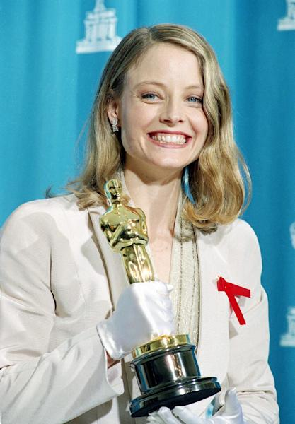 """FILE - In this March 30, 1992 file photo, Jodie Foster poses backstage with her Oscar at the 64th annual Academy Awards in Los Angeles, Calif. Foster won best actress in a leading role for her performance in """"Silence of the Lambs."""" (AP Photo/Reed Saxon, File)"""