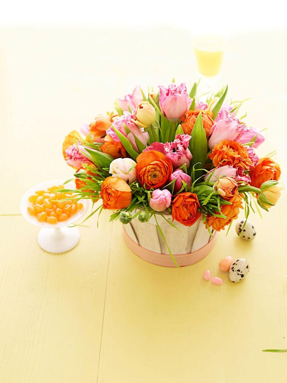 """<p>Gather vivid parrot tulips and ranunculus in similar tones in a ribbon-trimmed, whitewashed peck basket. Line with plastic wrap and pack with wet floral foam; add stems and grass.</p><p><a class=""""link rapid-noclick-resp"""" href=""""https://www.amazon.com/Texas-Basket-10-5-Handle-Peck/dp/B00N41FWGY?tag=syn-yahoo-20&ascsubtag=%5Bartid%7C10055.g.2217%5Bsrc%7Cyahoo-us"""" rel=""""nofollow noopener"""" target=""""_blank"""" data-ylk=""""slk:BUY PECK BASKET"""">BUY PECK BASKET</a> <br></p>"""
