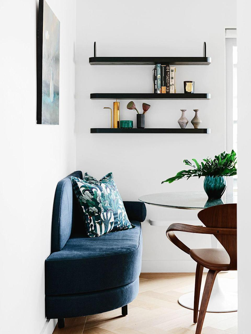 """<p>In smaller spaces, where a tulip table is all you can squeeze in, choose fun accent chairs and consider a built-in bench. A casual gallery wall or statement-making floating shelves displaying decor will spice things up without taking up any precious square footage. This breakfast nook designed by<a href=""""https://arentpyke.com/"""" rel=""""nofollow noopener"""" target=""""_blank"""" data-ylk=""""slk:Arent & Pyke"""" class=""""link rapid-noclick-resp""""> Arent & Pyke</a> proves it.</p>"""