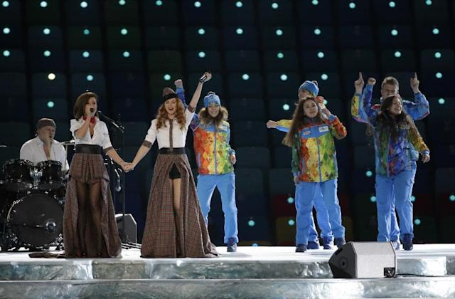 Russian duo t.A.T.u. Lena Katina, third from left, and Yulia Volkova, second from left, perform on stage before the opening ceremony of the 2014 Winter Olympics in Sochi, Russia, Friday, Feb. 7, 2014. (AP Photo/Mark Humphrey)