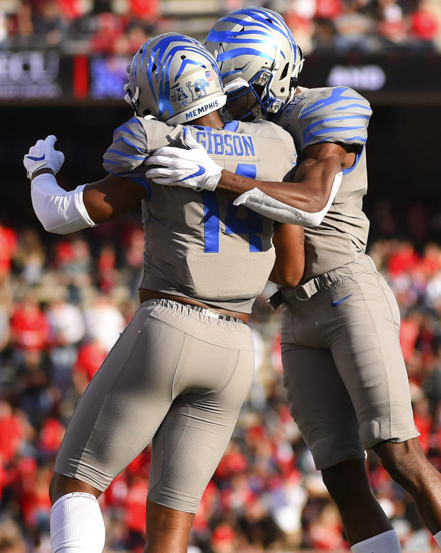 Memphis wide receiver Damonte Coxie, right, celebrates his touchdown with wide receiver Antonio Gibson during the first half of an NCAA college football game against Houston, Saturday, Nov. 16, 2019, in Houston. (AP Photo/Eric Christian Smith)