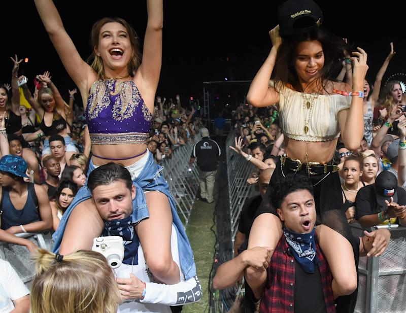 Hailey Baldwin and Kendall Jenner attend the Coachella Music Festival in Indio, California.
